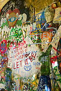 Detail photo of the John Lennon inspired graffiti on a Prague wall.