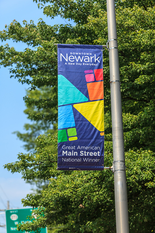 Newark, DE – June 24, 2013: City of Newark pole banner proclaiming downtown Main Street is a national award winner.