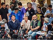 03 SEPTEMBER 2016 - BANGKOK, THAILAND: TAWATCHAI VORAMAHAKUN, center, a community historian and leader in the Pom Mahakan slum of the Pom Mahakan Fort negotiates with Bangkok city officials during a stand off in the fort. Hundreds of people from the Pom Mahakan community and other communities in Bangkok barricaded themselves in the Pom Mahakan Fort to prevent Bangkok officials from tearing down the homes in the community Saturday. The city had issued eviction notices and said they would reclaim the land in the historic fort from the community. People prevented the city workers from getting into the fort. After negotiations with community leaders, Bangkok officials were allowed to tear down 12 homes that had either been abandoned or whose owners had agreed to move. The remaining 44 families who live in the fort have vowed to stay.      PHOTO BY JACK KURTZ