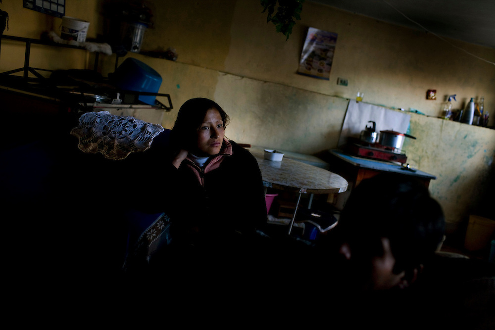 A family sits inside of their home in La Oroya Vieja, the part of town closest to the metal processing plant.  Studies show that nearly 100% of the children living in La Oroya have lead poisoning, and local doctors believe that there are an inordinately high number of cancer patients.