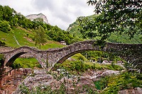 Old, roman, stone double-arched bridge in the outstandingly beautiful Valle Verzasca, Ticino, Switzerland.