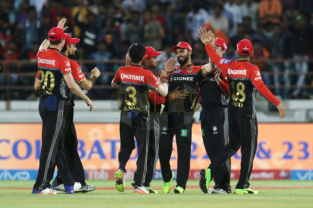 Royal Challengers Bangalore players celebrates the wicket of Dwayne Smith of the Gujarat Lions during match 20 of the Vivo 2017 Indian Premier League between the Gujarat Lions and the Royal Challengers Bangalore  held at the Saurashtra Cricket Association Stadium in Rajkot, India on the 18th April 2017<br /> <br /> Photo by Vipin Pawar - Sportzpics - IPL