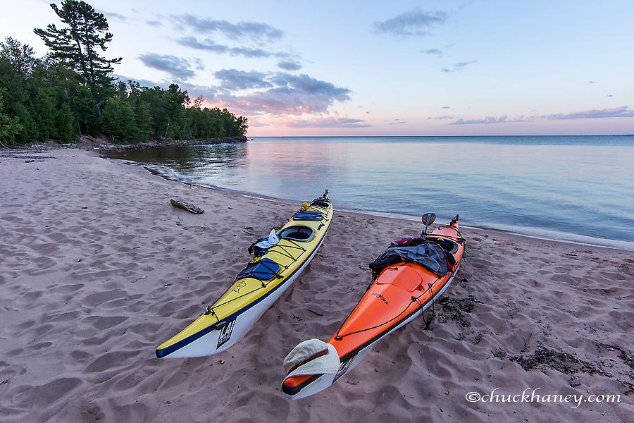 Kayaks on sand beach at York Island on the Apostle Islands National Lakeshore, Wisconsin, USA