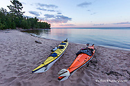 Kayaks on sand beach at York Island on the Apostle Islands National Lakeshore, Wisconsin, USA