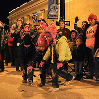 Adam Robison | BUY AT PHOTOS.DJOURNAL.COM<br /> Children race for the last piece of candy thrown out during the Tupelo Christmas Parade Friday night in Tupelo.