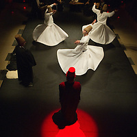 VENICE, ITALY - JUNE 21:  Whirling Dervishes of the Galata Mevlevi Ensemble,declared UNESCO World Heritage, perfom under the guidance of Sheikh Nail Kesova at Auditorium Candiani on June 21, 2011 in Venice, Italy. The whirling dance associated with Dervishes, is the practice of the Mevlevi Order in Turkey, and is part of a formal ceremony known as the Sema which is only one of the many Sufi ceremonies performed to try to reach religious ecstasy