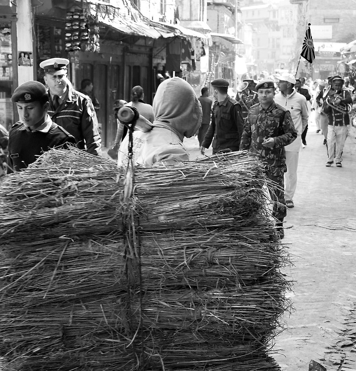A vendor carries his wares to market in Bhaktapur, Nepal
