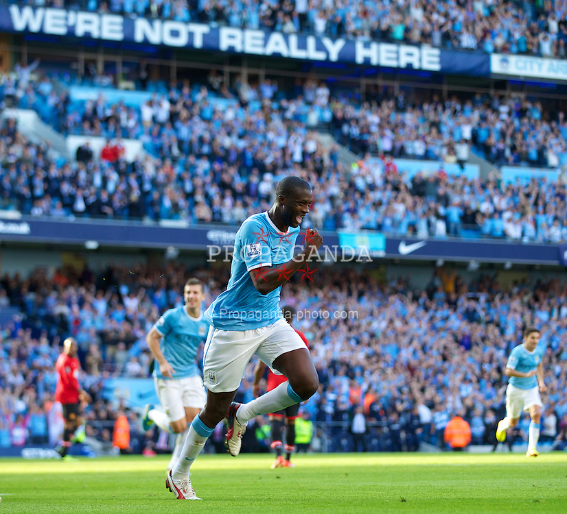 MANCHESTER, ENGLAND - Sunday, September 22, 2013: Manchester City's Yaya Toure celebrates scoring the second goal against Manchester United during the Premiership match at the City of Manchester Stadium. (Pic by David Rawcliffe/Propaganda)