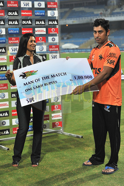 Mohnish Mishra of Pune Warriors India receives the man of the match award  during  match 10 of the Indian Premier League ( IPL ) Season 4 between the Pune Warriors and the Kochi Tuskers Kerala held at the Dr DY Patil Sports Academy, Mumbai India on the 12th April 2011..Photo by Pal Pillai /BCCI/SPORTZPICS