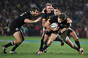 JOHANNESBURG, South Africa, 04 October 2014 : Beauden Barrett of the All Blacks is tackled by Jean de Villiers (C) and Jan Serfontein (Right) of the Springboks with Conrad Smith of the All Blacks in support during the Castle Lager Rugby Championship test match between SOUTH AFRICA and NEW ZEALAND at ELLIS PARK in Johannesburg, South Africa on 04 October 2014. <br /> The Springboks won 27-25 but the All Blacks successfully defended the 2014 Championship trophy.<br /> <br /> © Anton de Villiers / SASPA