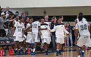 McNeil basketball team celebrate a conference win over Cedar Ridge Friday at home.  The Mavs beat the Raiders 66-56. in overtime.  (LOURDES M SHOAF for Round Rock Leader.)