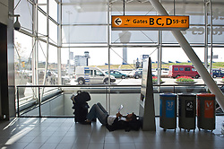 Alex Van Dalen, has been stranded in Amsterdam for five days, due to the ash cloud from a volcanic eruption in Iceland, and is waiting for a flight to Beijing, at Schiphol Airport in Amsterdam, the Netherlands, on Tuesday, April 20, 2010. (Photo © Jock Fistick)