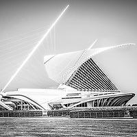 Milwaukee Art Museum picture in black and white. Located in Milwaukee Wisconsin in the United States, the Milwaukee Art Museum has over 30,000 works of art and 400,000 visitors a year. The museum preserves and collects art and also provides educational services. The photo is high resolution.