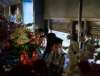 YANGON, MYANMAR - CIRCA DECEMBER 2017: People inside a typical wagon of the Yangon circular railway service.