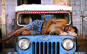 man dead asleep on jeep, delhi, india