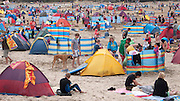Families on the beach at Perranporth, Cornwall.