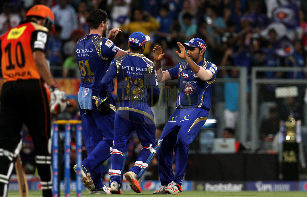 Mumbai Indians players celebrates the wicket of Sunrisers Hyderabad player KL Rahul during match 23 of the Pepsi IPL 2015 (Indian Premier League) between The Mumbai Indians and The Sunrisers Hyderabad held at the Wankhede Stadium in Mumbai India on the 25th April 2015.<br /> <br /> Photo by:  Vipin Pawar / SPORTZPICS / IPL