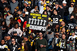 OAKLAND, CA - DECEMBER 09: Pittsburgh Steelers fans hold up a sign showing the number of Super Bowl championships their team has won during the second quarter against the Oakland Raiders at the Oakland Coliseum on December 9, 2018 in Oakland, California. The Oakland Raiders defeated the Pittsburgh Steelers 24-21. (Photo by Jason O. Watson/Getty Images) *** Local Caption ***