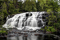 Bond Falls in Michigan's Upper peninsula.  A beautiful set of falls located near Paulding, Michigan on the Middle Branch of the Ontonagon River .  Image was taken in the spring 2012 while on a fishing trip to Lake Goegbic--was well worth the trip!! This image is recommended for Metallic paper.