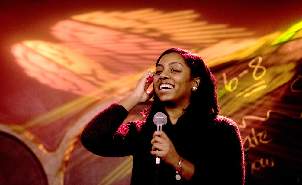 Maya Price laughs during her performance at Casa Nueva's MLK open mic night on Jan. 17, 2018. Photo by Meagan Hall