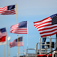 United States flags for the Independence Day Holiday are seen on the team haulers during the NASCAR Coke Zero 400 Sprint practice session at the Daytona International Speedway on Thursday, July 4, 2013 in Daytona Beach, Florida.  (AP Photo/Alex Menendez)