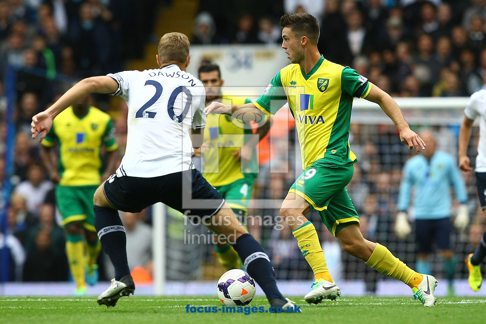 Picture by Paul Chesterton/Focus Images Ltd +44 7904 640267<br /> 14/09/2013<br /> Ricky Van Wolfswinkel of Norwich and Michael Dawson of Spurs in action during the Barclays Premier League match at White Hart Lane, London.