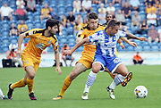 Colchester Utd defender Lewis Kinsella shields the ball during the EFL Sky Bet League 2 match between Colchester United and Cambridge United at the Weston Homes Community Stadium, Colchester, England on 13 August 2016. Photo by Nigel Cole.