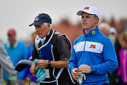 Conor Purcell (GB&I) and Caddy Sean Donnelly walk to the first hole during the Saturday morning Foursomes in the Walker Cup at the Royal Liverpool Golf Club, Saturday, Sept 7, 2019, in Hoylake, United Kingdom. (Steve Flynn/Image of Sport)