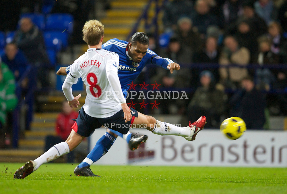 BOLTON, ENGLAND - Monday, January 24, 2011: Chelsea's Didier Drogba scores the opening goal against Bolton Wanderers during the Premiership match at the Reebok Stadium. (Photo by David Rawcliffe/Propaganda)