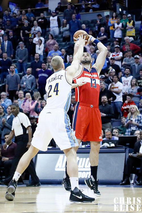 08 March 2017: Washington Wizards center Marcin Gortat (13) takes a jump shot against Denver Nuggets center Mason Plumlee (24) during the Washington Wizards 123-113 victory over the Denver Nuggets, at the Pepsi Center, Denver, Colorado, USA.
