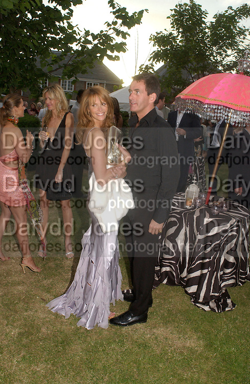 Elle Macpherson and Tim Jefferies, The  Summer party, hosted by the Serpentine Gallery and Robert Cavalli, 16 June 2004. 16 June 2004. SUPPLIED FOR ONE-TIME USE ONLY> DO NOT ARCHIVE. © Copyright Photograph by Dafydd Jones 66 Stockwell Park Rd. London SW9 0DA Tel 020 7733 0108 www.dafjones.com