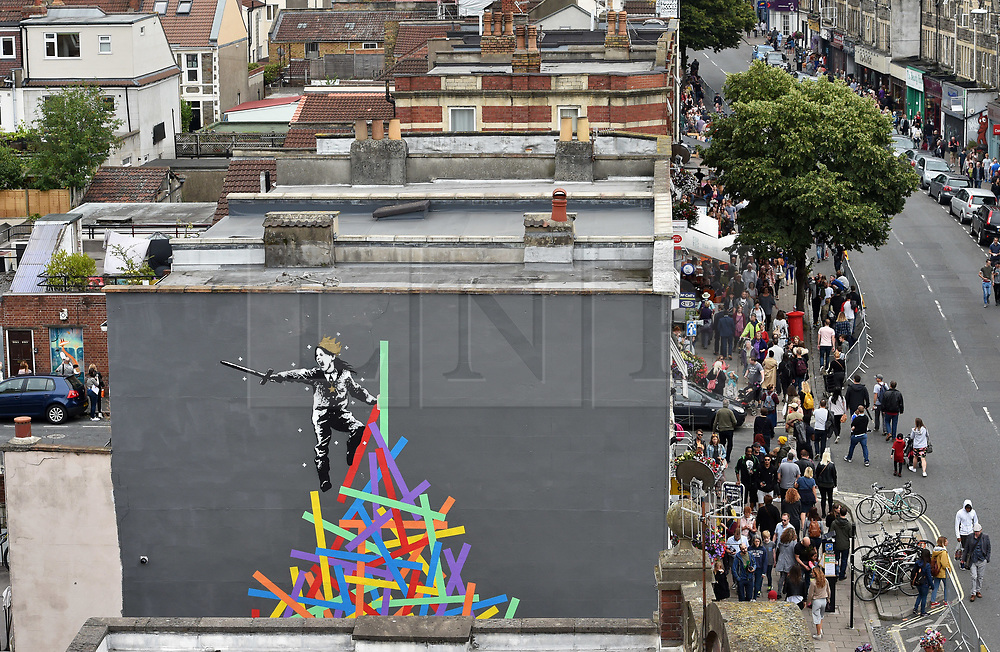 © Licensed to London News Pictures.  29/07/2017; Bristol, UK. Upfest 2017. A mural in progress created by artist Eelus on the side of a building for Upfest, Europe's largest street art festival held annually in Bedminster, Bristol. The festival officially runs from 29 - 31 July with over 350 artists live painting in 37 locations including this Ashton Gate stadium, home of Bristol City FC. Picture credit : Simon Chapman/LNP