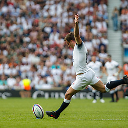 George Ford of England kicks a conversion for his team