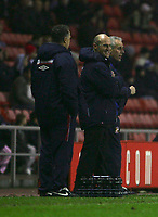 Photo: Andrew Unwin.<br />Sunderland v Northwich Victoria. The FA Cup. 08/01/2006.<br />Northwich's manager, Steve Burr (C), and Sunderland's manager, Mick McCarthy (R).