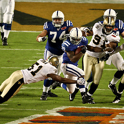 2010 February 07: New Orleans Saints linebacker Jonathan Vilma (51) makes a diving attempt at a tackle on Indianapolis Colts running back Joseph Addai (29) during a 31-17 win by the New Orleans Saints over the Indianapolis Colts in Super Bowl XLIV at Sun Life Stadium in Miami, Florida.