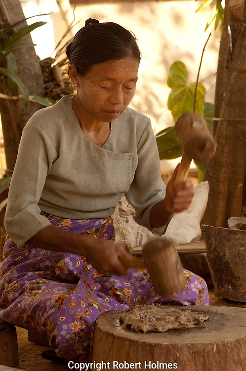 Pounding mulberry bark to make paper for parasols in Pindaya