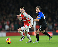 Arsenal's Callum Chambers tussles with Bournemouth's Harry Arter<br /> <br /> <br /> Barclays Premier League- Arsenal vs AFC Bournemouth - Emirates Stadium - England - 28th December 2015 - Picture - David Klein/Sportimage