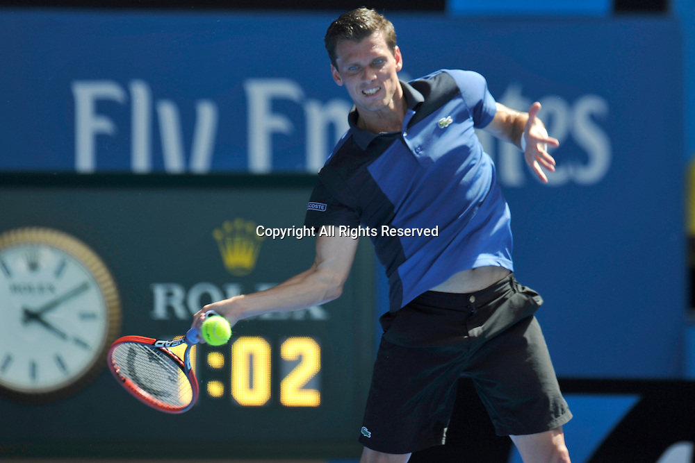 19.01.2015 Australian Open Tennis from Melbourne Park. Tobias Kamke of Germany hits a return shot in his match against Bernard Tomic of Australia on day one of the 2015 Australian Open at Melbourne Park, Melbourne, Australia.