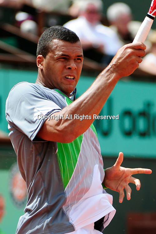 22.05.2011 French Open Tennis from Roland Garros Paris. Jo-Wilfried Tsonga of France looks on after hitting a return shot in his match against Jan Hajek of the Czech Republic on day one of the French Open tennis championships. The match was won by Tsonga 6-3, 6-2, 6-2.