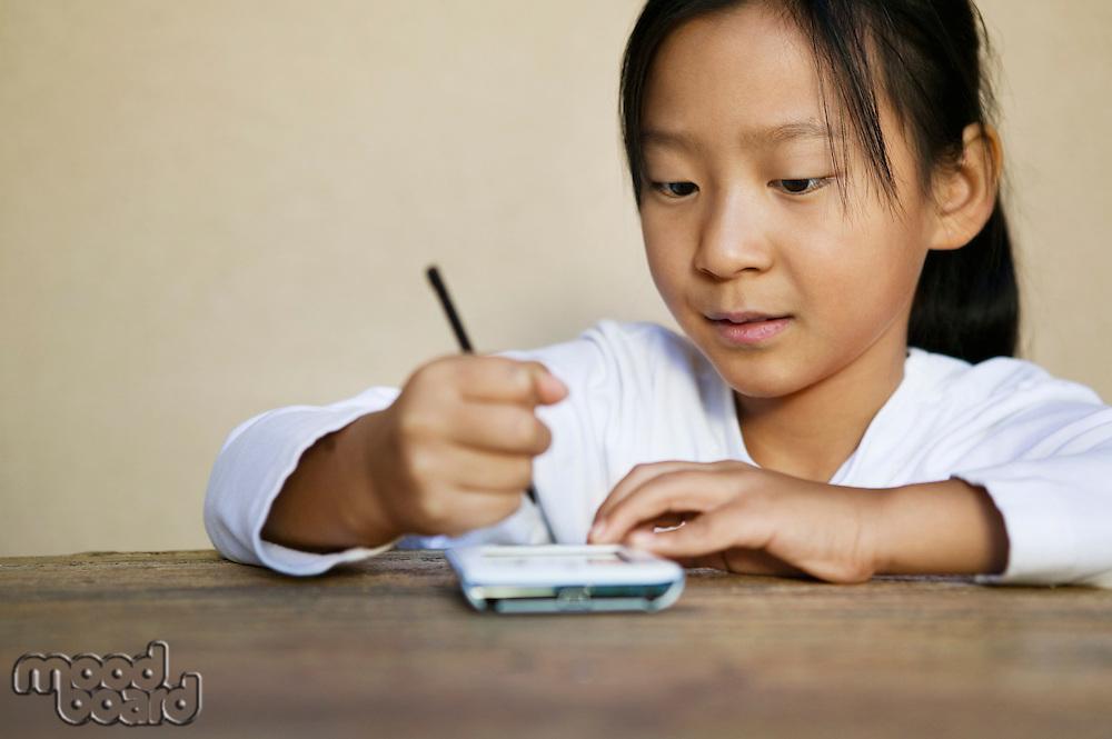 Girl using PDA