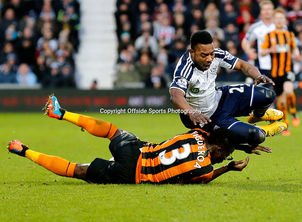 10th January 2015 - Barclays Premier League - West Bromwich Albion v Hull City - Stephane Sessegon of West Bromwich Albion goes over a challenge from Maynor Figueroa of Hull City - Photo: Paul Roberts / Offside.