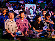 "15 JUNE 2018 - SEOUL, SOUTH KOREA:  South Koreans listen to speakers during a rally to mark the anniversary of the signing of the June 15th North–South Joint Declaration between South Korea and North Korea. A placard honor the recent inter Korean summit between North Korean leader Kim Jong-un and South Korean President Moon Jae-in is in the crowd. The Declaration was negotiated by late South Korean President Kim Dae-jung and North Korean leader Kim Jong-il and signed on 15 June 2000. It was a part of South Korea's ""Sunshine Policy,"" which guides the South's relationship with North Korea. This year's observance of the anniversary was bolstered by the recent thawing in relations between North Korea and South Korea and the US.    PHOTO BY JACK KURTZ"