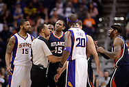 Mar. 1, 2013; Phoenix, AZ, USA; NBA official Rodney Mott (71) breaks up the arguing Atlanta Hawks center Al Horford (15) and Phoenix Suns center Jermaine O'Neal (20) in the second half at US Airways Center. The Suns defeated the Hawks 92-87. Mandatory Credit: Jennifer Stewart-USA TODAY Sports