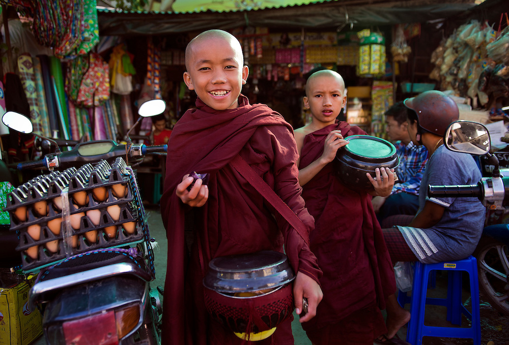 Novices leaving a store, Myanmar.