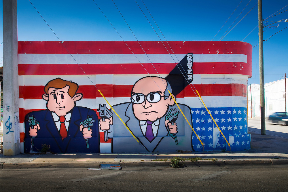 Gun-weilding caricatures of President George W. Bush and Vice-President  Dick Cehney photographed in Miami's Wynwood neighborhoof in 2009.