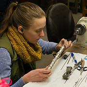 Katharine Scharff studies her work