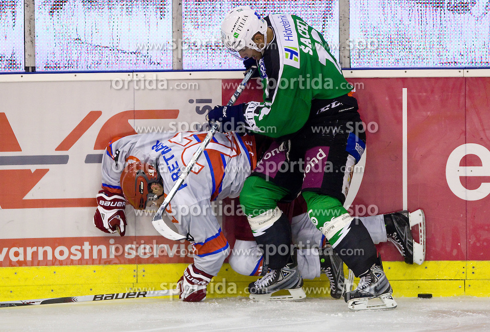 Klemen Pretnar of Jesenice vs Petr Sachl of Olimpija during ice-hockey match between HD Tilia Olimpija and HK Acroni Jesenice  in 6th Round of EBEL league, on September 26, 2010 at Hala Tivoli, Ljubljana, Slovenia. (Photo By Vid Ponikvar / Sportida.com)