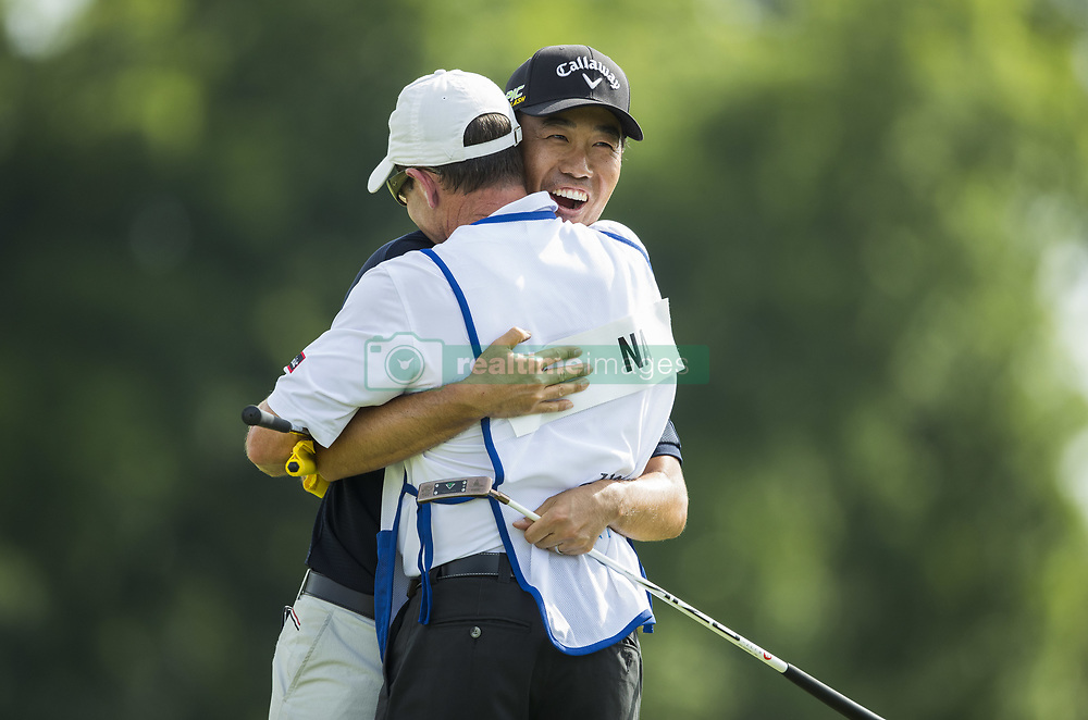 May 26, 2019 - Fort Worth, TX, USA - Kevin Na hugs caddie Kenny Harms after winning the 2019 Charles Schwab Challenge PGA at Colonial Country Club. (Credit Image: © Erich Schlegel/ZUMA Wire)