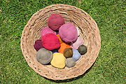Basket of naturally dyed alpaca yarn for weaving cloth in Misminay Village, Sacred Valley, Peru.