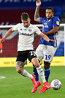 Football - 2019 / 2020 Championship - Play-off semi-final - 1st leg - Cardiff City vs Fulham<br /> <br /> Joe Bryan of Fulham\ on the attack Nathaniel Mendez-Laing of Cardiff City defends <br /> in a match played with no crowd due to Covid 19 coronavirus emergency regulations, in an almost empty ground, at the Cardiff City Stadium<br /> <br /> COLORSPORT/WINSTON BYNORTH